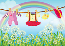 Kids clothes hanging near the grass. Illustration of the kids clothes hanging near the grass Royalty Free Stock Photos