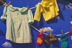 Kids clothes hanging on a washing line Stock Image