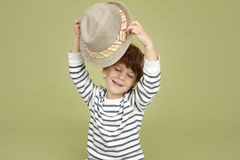 Kids Clothing and Fashion: Expressive Child with Fedora Hat. Kids, children clothing and fashion. Expressive, emotional boy with a fedora hat, posing and having stock photo