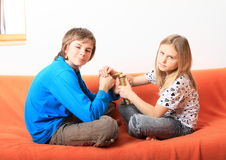 Kids with coffee grinder Royalty Free Stock Image