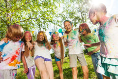 Kids colored with color powder dancing  outdoor Royalty Free Stock Image