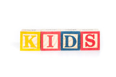 KIDS with colorful alphabet blocks on white background Stock Image