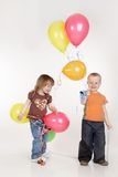 Kids with colorful balloons over white Stock Photography