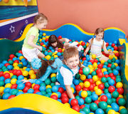 Kids in colorful balls Royalty Free Stock Image