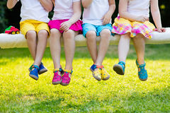 Kids with colorful shoes. Children footwear. Footwear for children. Group of preschool kids wearing colorful leather shoes. Sandal summer shoe for young child stock photo