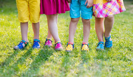 Kids with colorful shoes. Children footwear. Footwear for children. Group of preschool kids wearing colorful leather shoes. Sandal summer shoe for young child Royalty Free Stock Photo