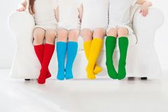 Kids with colorful socks. Children footwear. Kids wearing colorful rainbow socks. Children footwear collection. Variety of knitted knee high socks and tights Royalty Free Stock Image
