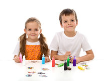 Kids coloring with lots of small painting bottles Royalty Free Stock Photo