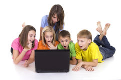 Kids with computer. Cute five kids with computer on white Stock Images