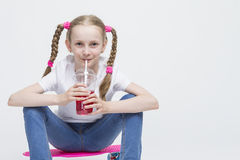 Kids Concepts. Little Caucasian Blond Girl Posing with Pink Penn Royalty Free Stock Photo