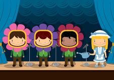 Kids Concert _ Performance _ Play. Young children acting out a nursery rhyme on stage Stock Image