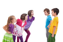 Kids confronting and mocking each other. Girls and boys apart Royalty Free Stock Images