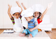 Kids in cook costumes. African american kids in cook costumes raising hands Royalty Free Stock Images