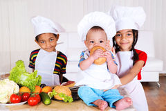 Kids cooking royalty free stock photos