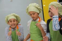 Kids cooking battle Stock Photos