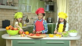 Kids cooking food at table. Little girl holding a tablet. Best cookery apps stock video footage