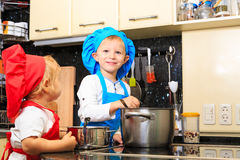 Kids cooking in kitchen interior Royalty Free Stock Photo