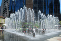 Kids cool off in fountain Stock Images