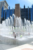 Kids cool off in water fountain Royalty Free Stock Image