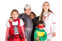 Kids in costumes. Group of kids in Halloween/Carnaval costumes isolated Royalty Free Stock Photography