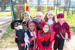 Kids in costumes. Group of kids in Halloween costumes in a park Royalty Free Stock Images