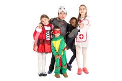 Kids in costumes. Group of kids in Halloween/Canaval costumes isolated Stock Photography