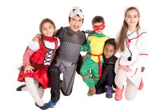 Kids in costumes. Group of kids in Halloween/Canaval costumes isolated Stock Image