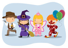 Kids Costumes. Young children wearing different costumes Stock Images
