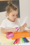 Kids crafts. Little girl hands cutting paper with scissors on the art lesson class. Children education concept. Learn Study Education School Knowledge Concept Royalty Free Stock Image
