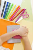 Kids crafts. Little girl hands cutting paper with special paper puncher on the art lesson class. Children education concept. Learn Study Education School Royalty Free Stock Images
