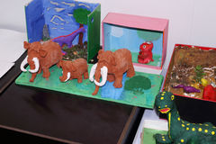 Kids crafts mammoths in Museum Royalty Free Stock Photos