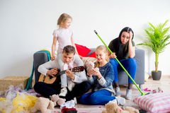 Kids created a mess at home. And mother has to clean it up Stock Photos