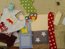 Kids creation table with fabrics, canvas and pacifier. Crafts table with fabrics, glue and pacifier stock photography