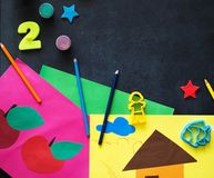 Kids creativity crafts on a chalkboard stock photo