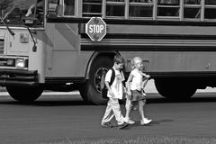 Kids Crossing the Street. Coming Home From School Stock Photo