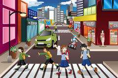 Kids crossing the street Royalty Free Stock Image