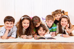 Kids crowd reading book Royalty Free Stock Photography