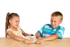 Kids and a cupcake Stock Photos
