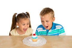 Kids and a cupcake Stock Image