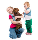 Kids with dachshund Royalty Free Stock Photography