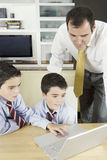 Kids with Dad on Laptop Royalty Free Stock Photos