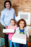 Kids with dad and pizza boxes royalty free stock photos