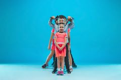 The kids dance school, ballet, hiphop, street, funky and modern dancers. On blue studio background Stock Photos