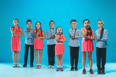 The kids dance school, ballet, hiphop, street, funky and modern dancers. On blue studio background Stock Photo