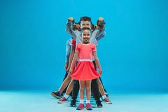 The kids dance school, ballet, hiphop, street, funky and modern dancers. On blue studio background Royalty Free Stock Photos