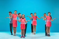 The kids dance school, ballet, hiphop, street, funky and modern dancers. On blue studio background stock images