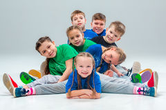 The kids dance school, ballet, hiphop, street, funky and modern dancers. On gray studio background stock photos