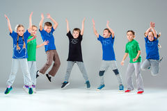 The kids dance school, ballet, hiphop, street, funky and modern dancers. On gray studio background stock image