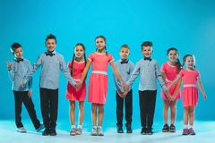 The kids dance school, ballet, hiphop, street, funky and modern dancers. On blue studio background Stock Photography