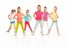 The kids dance school, ballet, hiphop, street, funky and modern dancers. On white studio background. Girl is showing aerobic and dance element. Teen in hip hop royalty free stock photo